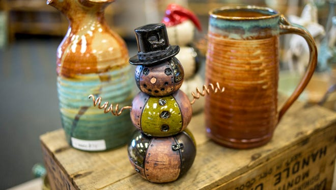 A steampunk style snowman by potter Juliet Faber displayed during the Potters Market Saturday, Nov. 12, 2016  at the SC4 Welcome Center.
