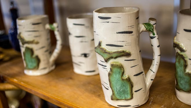 Birch tree style mugs by potter Dennis Snyder displayed during the Potters Market. The St. Clair County Community College 16th annual Potters Market is Nov. 15-18.