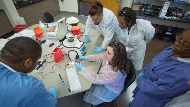Students learn blood testing techniques in the Vol State Medical Lab. Left to right: Jarvis Cox-Burgess of Murfreesboro; instructor Kimberly Hammers of Nashville; Tanesha Wallace of Nashville; Iya Stover of Nashville; and Richard Fowler of Ashland City.