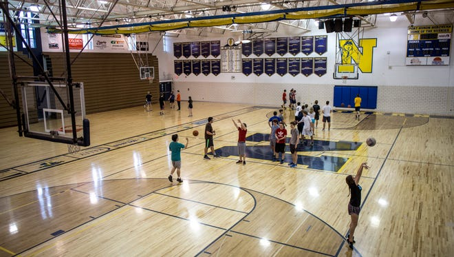 Students use the gym Tuesday, Nov. 22, 2016 at Port Huron Northern High School. A parent group has raised $7,000 to help fund replacement basketball equipment.