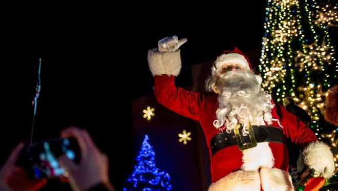 Santa speaks to the crowd during the Santa Parade Friday, Nov. 25, 2016 in downtown Port Huron.