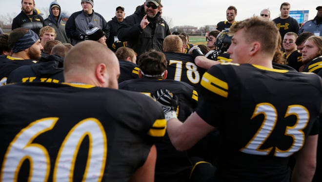 UW-Oshkosh coach Pat Cerroni talks to his team after an NCAA Division III playoff win in 2016.
