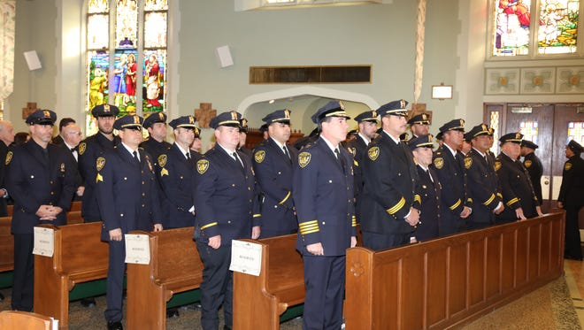 Belleville police officers pay attention during a Blue Mass held in St. Peter's Roman Catholic Church in Belleville Nov. 20.