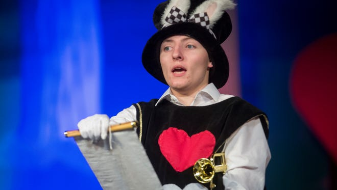"""Yorktown's cast and crew rehearse """"Alice in Wonderland"""" Tuesday night at the Yorktown High School Auditorium before opening night on Thursday. The show will run Dec. 1-3."""