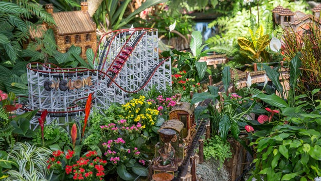 This November 2016 photo provided by the New York Botanical Garden shows the Garden's annual holiday train show in the Bronx borough of New York. The show features miniature replicas of New York City landmarks, all made from natural materials like twigs and pine cones.