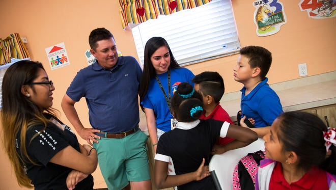 PGA Tour golfer Jason Dufner meets and talks with children during their after-school lunchtime at Grace Place for Children and Families in Naples, Fla., on Monday, Dec. 5, 2016. Dufner's foundation made a donation to Grace Place for its upcoming holiday meal program, which provides complete dinners to approximately 450 families.