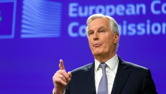 Michel Barnier, Chief Negotiator for the Preparation and Conduct of the Negotiations with the United Kingdom under Article 50 of the Treaty of the European Union, speaks during a media conference at EU headquarters in Brussels on Tuesday, Dec. 6, 2016. (AP Photo/Thierry Monasse)