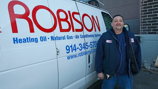 Layne Beatty of Ossining, a service technician for Robison Oil, at their Elmsford office.