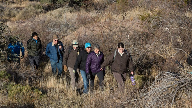 McKinney Briske, an outdoor recreation planner, leads Secretary of the Interior Sally Jewell, along with staff from the Bureau of Land Management, and few members of the Friends of the Organ Mountains-Desert Peaks, through the trails at the Organ Mountains-Desert Peaks National Monument. Friday, December 9, 2016.