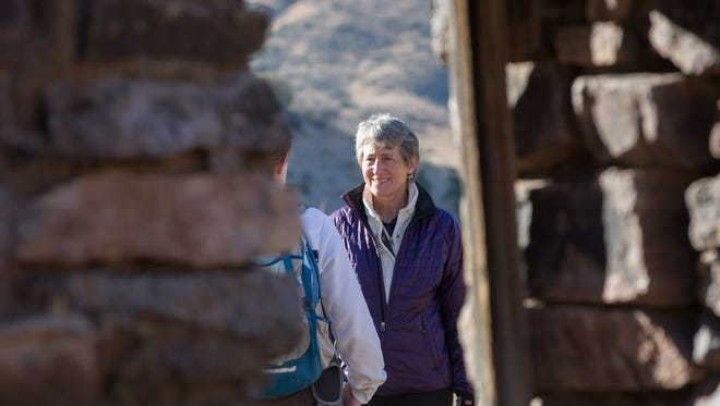 Secretary of the Interior Sally Jewell hikes in the Organ Mountains- Desert Peak National Monument, through Soledad Canyon, on Friday, Dec. 9, 2016. taking a break to talk with members of the Bureau of Land Management and Friends of Organ Mountains-Desert Peaks.