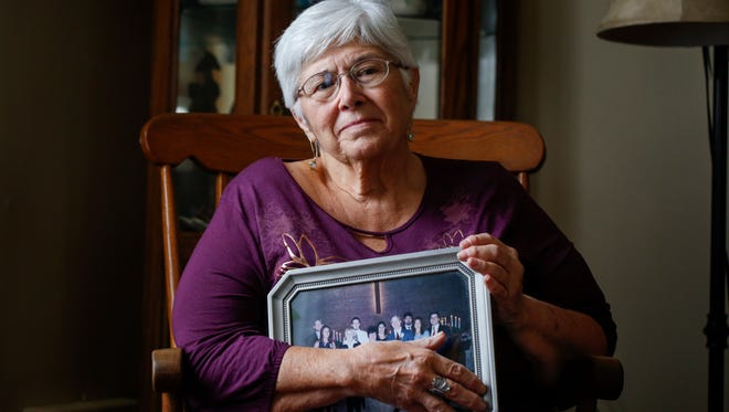 Judy Jenkins hold a family picture as she thinks about her daughter Lydia Dale Huebner on Dec. 7, 2016, at her home in Tullahoma, Tenn. Her daughter was addicted to opioids and died of an accidental overdose in 2015.