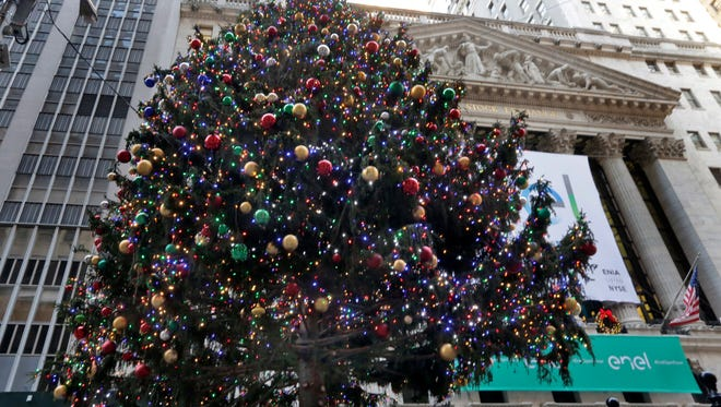 The 93rd annual New York Stock Exchange Christmas Tree lights-up Broad Street, Friday, Dec. 2, 2016. The U.S. stock market is staging an unprecedented, historical rally, with the Dow Jones industrial average on a path to break the 20,000 barrier for the first time.