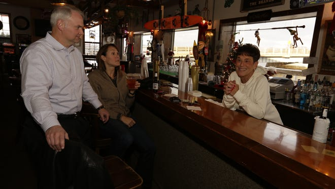 Tom and Shari Quigley stop in for a drink at The Other Place and talk with owner, Mary Holtz who will be closing the doors due to the replacement of the Winneconne bridge.  The new bridge will take about 15 feet of the building which she owns.  The last day for business is December 17. Joe Sienkiewicz / USA TODAY NETWORK-Wisconsin
