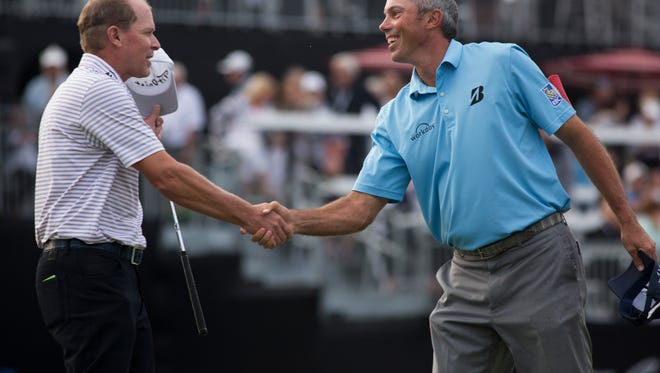 Steve Stricker and Matt Kuchar shake hands after Kuchar sinks the final putt to seal his team's victory during the final round of the Franklin Templeton Shootout at Tibur—n Golf Club at The Ritz-Carlton Golf Resort Saturday, Dec. 10, 2016 in Naples.