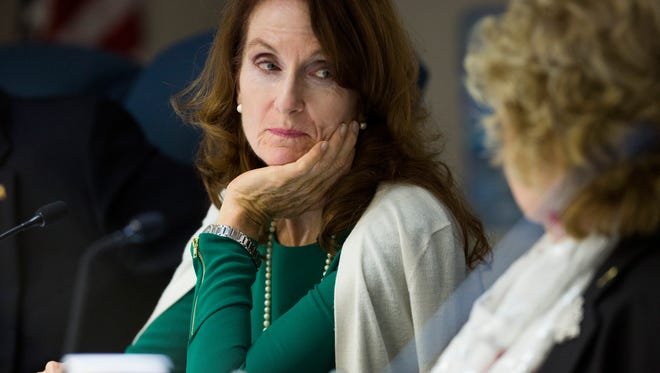 District 4 Commissioner Penny Taylor listens to District 1 Commissioner Donna Fiala during a Board of County Commissioners Meeting Tuesday, Dec. 13, 2016 in Naples. The Board of County Commissioners voted on a recommendation to award a contract for the extension of Logan Boulevard from Azalea Drive to the Lee County line to be fulfilled by Bonness, Inc. Tuesday, Dec. 13, 2016 in Naples. The board approved the contract.