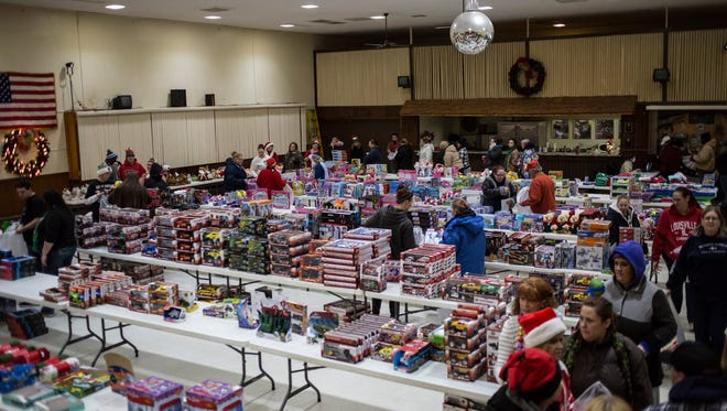 People walk among hundreds of donated toys during the annual Toys for Kids event Wednesday, Dec. 14, 2016 at the American Legion Post 8 in Port Huron.