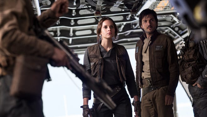 """This image released by Lucasfilm Ltd. shows Felicity Jones and Diego Luna, right, in a scene from, """"Rogue One: A Star Wars Story."""""""