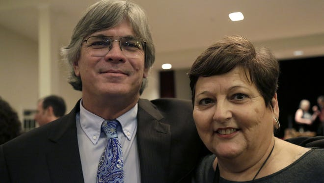 Andy Thomas, former chief assistant to Nancy Daniels will succeed her as Public Defender for the Second Judicial circuit. Here, he poses with a law school classmate of Daniels's at her retirement party at the Women's Club Dec 12.