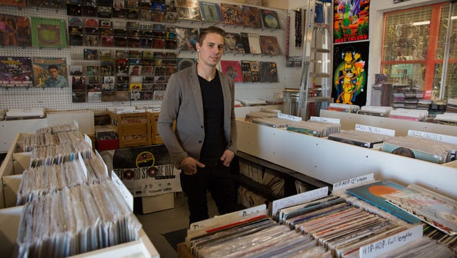 Justin Tyskewicz, owner of Eyeconik Records and Apparel in his record shop, Tuesday, December 20, 2016.