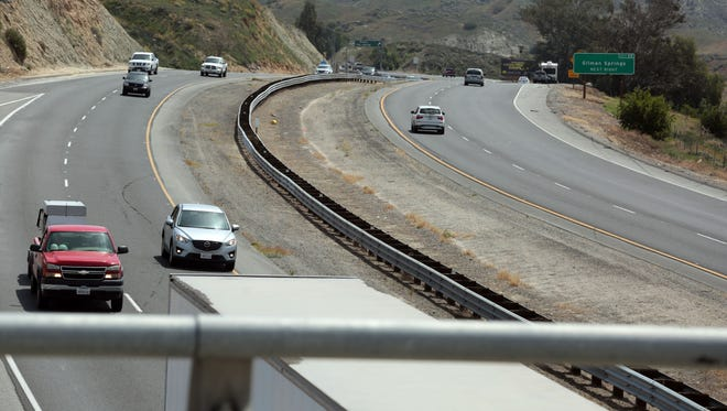 Traffic on the 60 freeway head into and out of the badlands on Tuesday, April 26, 2016 in Moreno Valley.