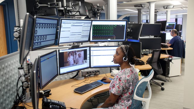 Shantelle Fleury, a register nurse at the Westchester Medical Center, speaks with a patient and his nurse at the MidHudson Regional Hospital in Poughkeepsie, while in the telehealth control center at Westchester Medical Center in Valhalla Dec. 22, 2016.