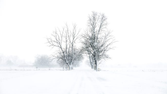 Snow blankets the landscape in this file photo.