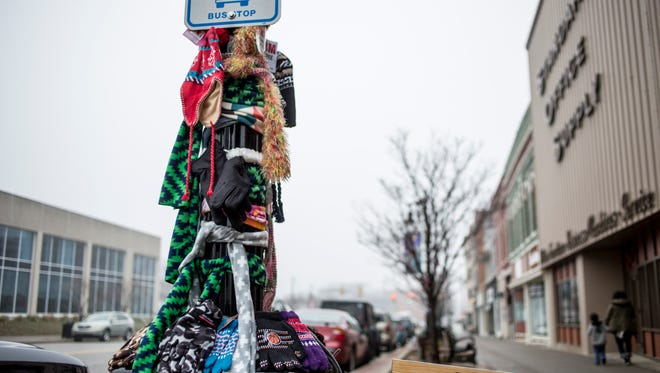 "Staff at The Raven Cafe have created a ""Scarf Pole"" as seen Tuesday, Jan. 3, 2017 in downtown Port Huron. Anyone in need can take items off the pole, and those wishing to donate can bring items to the cafe."