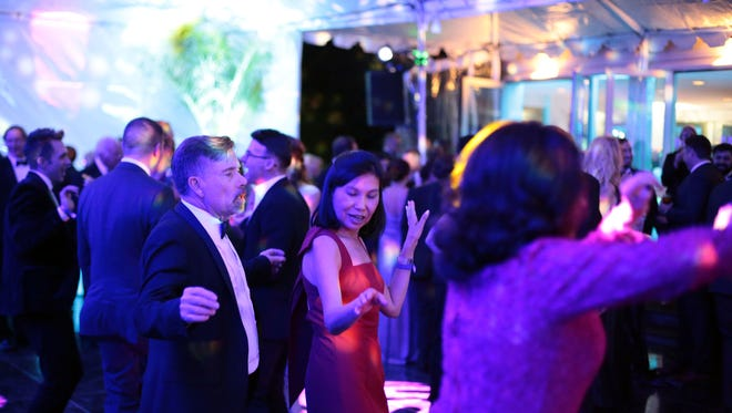 Guests attend the after party for the Palm Springs International Film Festival Gala on Monday, January 2, 2016 in Palm Springs. Mahershala Ali is also pictured on the right corner.