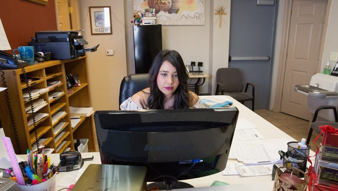 Elizabeth Contreras sits at her desk, waiting for clients to arrive at Lujan and Avalos Accounting firm Tuesday January 3, 2017.