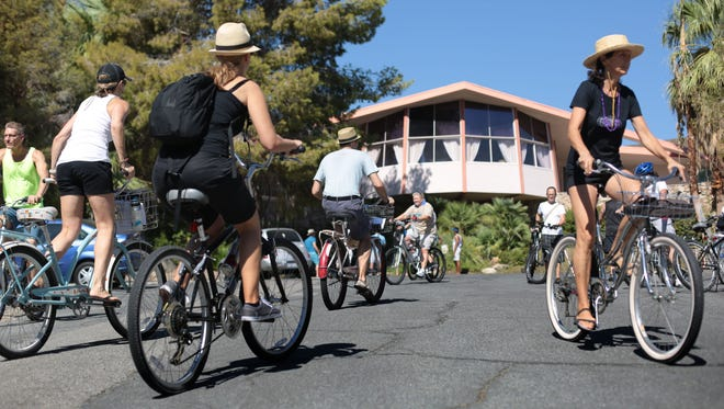 Cyclists stop by the Elvis Honeymoon House by William Krisel during the Mid-century Bike Ride on Saturday, October 11, 2014 in Palm Springs.