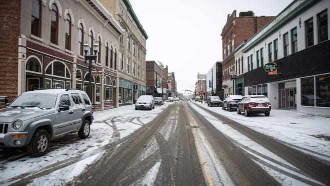 Area residents dealt with plummeting termperatures and falling snow most of Thursday. Temperatures will remain low for a majority of the weekend according to the National Weather Service.