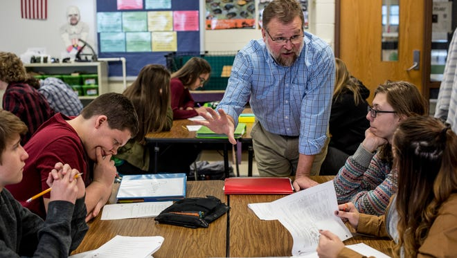 Teacher Mark Eberhard discusses a lesson with a group of students during a freshman biology class Thursday, Jan, 5, 2017 at St. Clair High School. Eberhard has been awarded the Excellence in Education award by the Michigan Lottery.