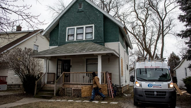 Windows and doors are boarded up Friday, Jan. 6, 2016 at 2010 Farrand Street in Port Huron.