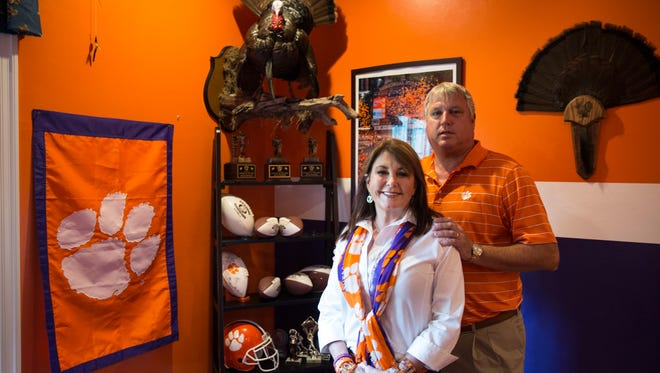 Brian and Jeanne Penner pose for a portrait at their home in Naples, Fla., on Friday, Jan. 6, 2017. Their son Seth plays as a redshirt freshman for the Clemson Tigers who will play against Alabama on Monday night in the College Football Playoff title game.