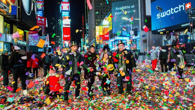 People celebrate after taking part in the New Year's eve at Times Square on January 1, 2017 in New York. / AFP / EDUARDO MUNOZ ALVAREZ        (Photo credit should read EDUARDO MUNOZ ALVAREZ/AFP/Getty Images)
