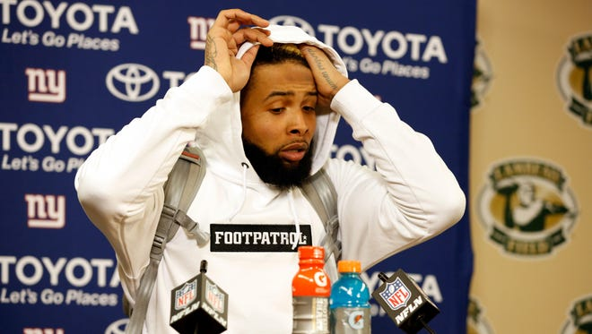 New York Giants wide receiver Odell Beckham (13) speaks at a news conference after an NFC wild-card NFL football game against the Green Bay Packers, Sunday, Jan. 8, 2017, in Green Bay, Wis. The Packers won 38-13. (AP Photo/Matt Ludtke)