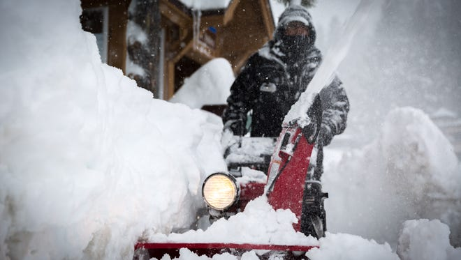 A worker operates a snowblower on Tuesday, January 10, 2017 at Squaw Valley Resort just north of Lake Tahoe.