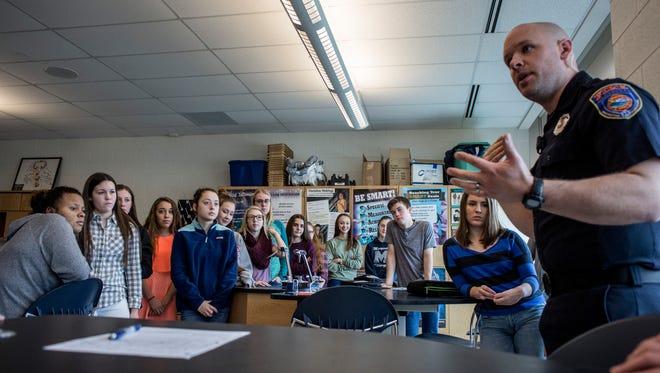 Students listen as Marysville firefighter Matthew Reeves talks about CPR during a freshman health class Wednesday, Jan. 11, 2016 at Marysville High School.
