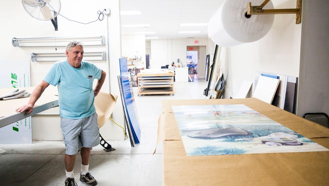 Owner Peter Pilger of Hitek Imaging transfers artwork on to aluminum boards at their shop in Naples on Thursday, Jan. 12, 2017. The artwork is to be displayed outdoors at the Marco Island Historical Museum as a part of an exhibition called Windows & Doors to History.