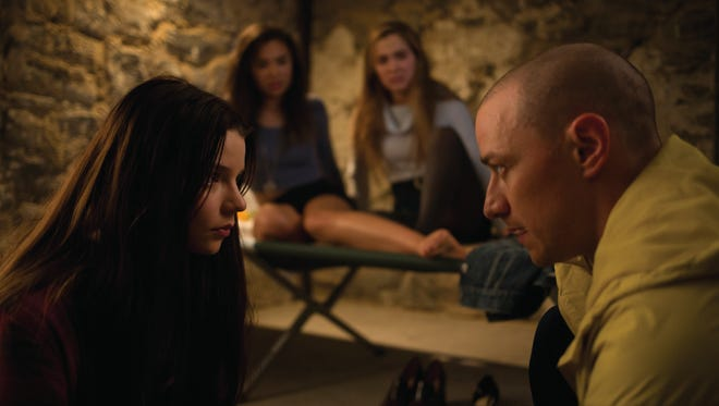 """Hedwig, one of James McAvoy's personalities, speaks with (from left) Casey (Anya Taylor-Joy), Claire (Hayley Lu Richardson) and Marcia (Jessica Sula), in M. Night Shyamalan's thriller """"Split."""""""
