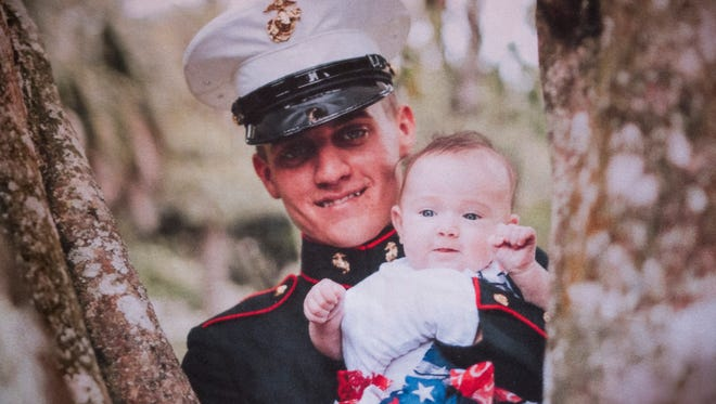A picture of Marine Austin Ruiz and his niece Alyana, 1, adorns a blanket in the family's living room Tuesday, Jan. 17, 2017 in Golden Gate Estates. Austin Ruiz was killed Friday, Jan. 13, 2017 during a Marine training exercise in Twentynine Palms, California.