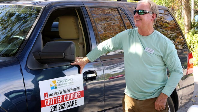Tim Thompson, critter courier with the Conservancy of Southwest Florida, gets ready to jump into his SUV suited up with a ladder on Jan. 17, 2017. He's accumulated more than 1,000 hours as a volunteer.