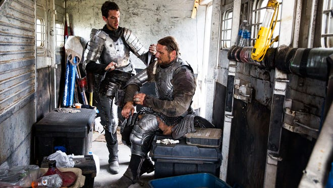 Tom Buckley, 24, of Syracuse, left, helps David Schade, 40, of Sarasota take off his armor in the back of a horse trailer following a joust during the Medieval Faire at Lakes Regional Park in Fort Myers on Sunday, Jan. 15, 2017. Buckley and Schade are professional jousters with The New Riders of the Golden Age from War Horse Farm, a traveling performance company from Sarasota.