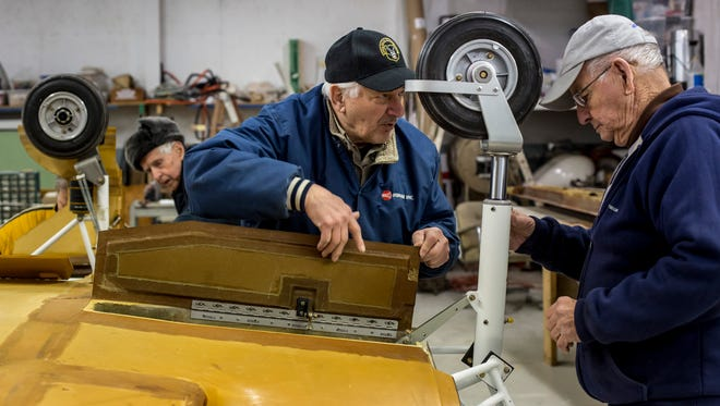 Rich Miskaitis and John Beattie look over the landing gear on a fuselage Thursday, Jan. 19, 2017 at the Experimental Aircraft Association Blue Water Chapter 979 at the St. Clair County Airport in Kimball Township.