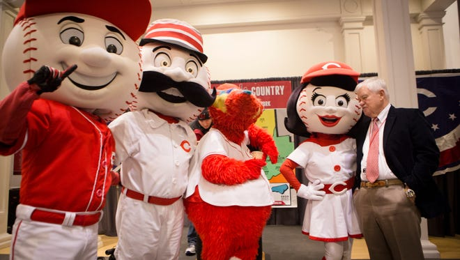 Thu., Jan. 26, 2017: Cincinnati Reds owner Bob Castellini talks with Rosie Red and other mascots, Ifrom left: Mr. Red, Mr. Redlegs and Gapper) at the Cincinnati Reds Hall of Fame and Museum, before the annual Cincinnati Reds Caravan departed Thursday morning from Great American Ball Park.