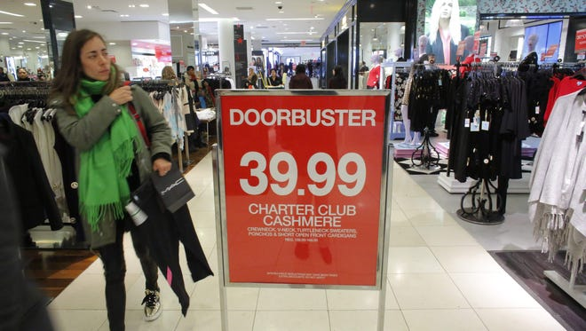 This file photo taken on November 25, 2016 shows people as they shop at Macy's department store in New York.