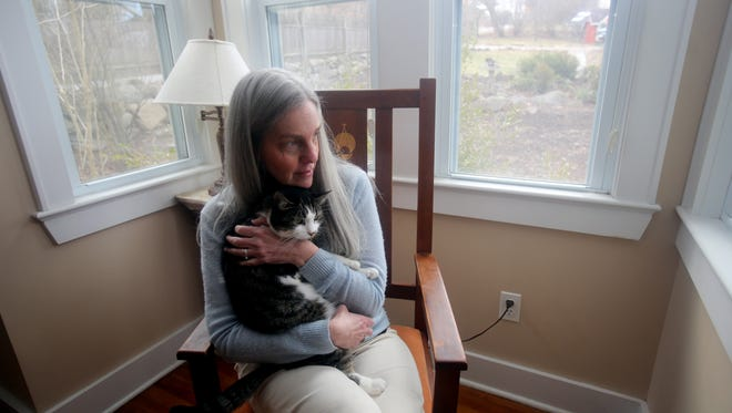 Tina Traster of Valley Cottage, photographed with one of her four cats Jan. 27, 2017, is the director of Catnip Nation, a documentary film on the issue of feral cats and feral cat colonies. On Feb. 4th, a a newly formed group, Community Cats Initiative in Rockland, will host a Catnip Nation House Party Fundraiser to help raise funds for the production of the film.