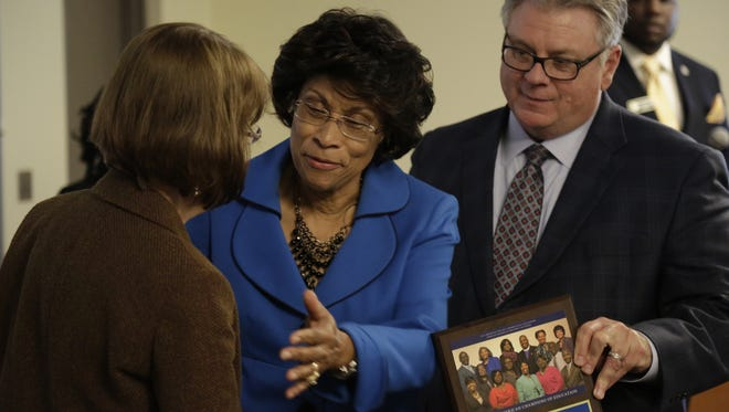 Retired educator Lenita Joe, center, receives congratulations from TCC Trustee Donna Callaway and TCC President Jim Murdaugh at the luncheon honoring the faces of TCC's 17th annual African-American History Calendar Monday.