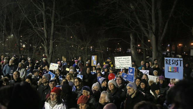 People gather during a rally to protest the recent executive order by President Trump on immigration at Chappaqua Gazebo on Feb. 1, 2017.