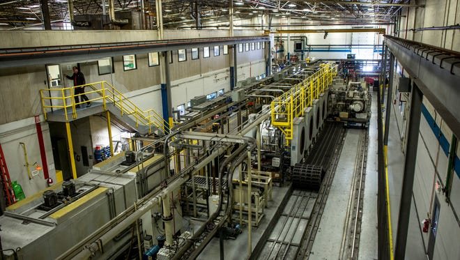 Automotive components are loaded into vacuum furnaces by an automated process Wednesday, Feb. 1, 2017 at ALD Thermal Treatment, 2656 24th Street in Port Huron.
